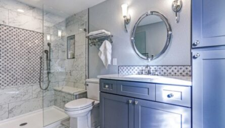 blue bathroom remodel with gray shower